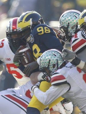 Michigan's Devin Gardner is sacked against Ohio State in Ann Arbor on November 30,  2013.