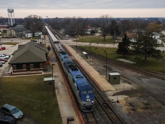 An Amtrak train stops to pick up passengers at the