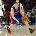 Detroit Pistons guard Steve Blake shoots over Washington Wizards forward Jared Dudley and center Nene Hilario during the first half Monday at Verizon Center.
