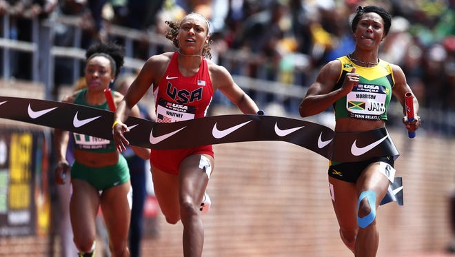 Kaylin Whitney, of the United States, at the finish line to win the USA vs. the World Women's 4x100-meter race at the Penn Relays athletics meet in Philadelphia. Whitney, the soon-to-be high school senior passed on a college career to turn pro early, signing a shoe deal on her 17th birthday in March. She hopes to make the final in the 100 and 200 this week at nationals in Eugene, Ore. Next summer, even bigger ambitions: Earn a spot for the Rio Olympics.