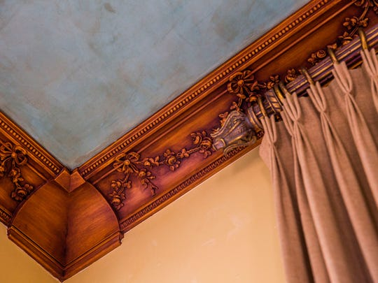 New homeowners have added faux crown moldings with ornate designs to reflect the Parisian style.
