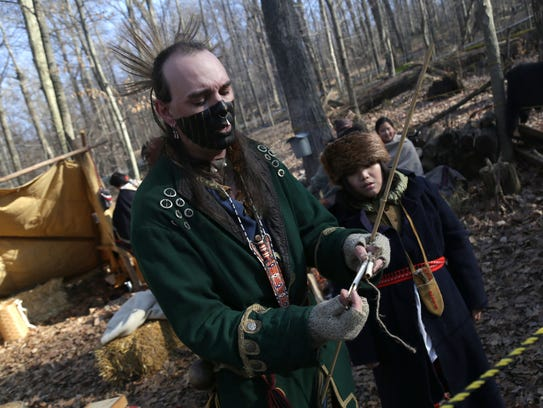 Jeremy Moore demonstrates how Native Americans harvested
