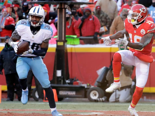 Tennessee Titans cornerback LeShaun Sims (36) intercepts a pass intended for Kansas City Chiefs wide receiver Jeremy Maclin (19) during the second half of an NFL football game in Kansas City, Mo., Sunday, Dec. 18, 2016. (AP Photo/Charlie Riedel)