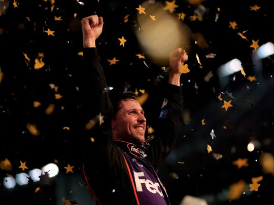 Denny Hamlin celebrates Saturday after winning the NASCAR Sprint Cup Series Sprint All-Star Race at Charlotte Motor Speedway in Charlotte, N.C.