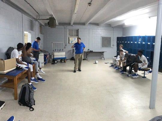 John Carroll Catholic coach Jimmy Hebb talks to his
