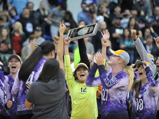 Mission Oak celebrates after winning the final point against Yosemite in a Central Section Division III girls volleyball championship game at COS on November 11, 2017