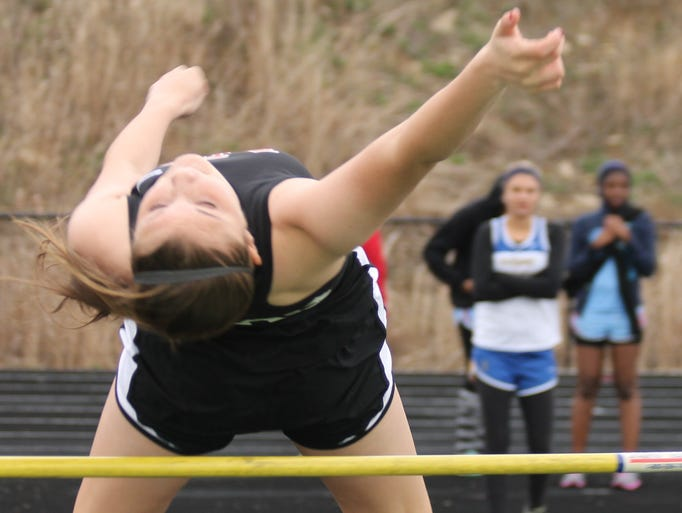 New Richmond High School freshman Lexi Forsee clears the bar in the girls high jump during the Division II and III Coaches Classic track and field meet April 4 at McNicholas.