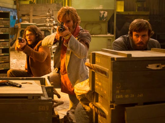 """This image released by A24 shows, from left, Noah Taylor, Jack Reynor, Sharlto Copley and Armie Hammer in a scene from """"Free Fire."""""""