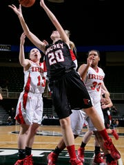Marine City Cardinal Mooney's Katie Theut (20) puts up a shot between Mt. Pleasant Sacred Heart's Riley Theut (13) and Averi Gamble (33) Thursday, March 13, 2014, in East Lansing, Mich.