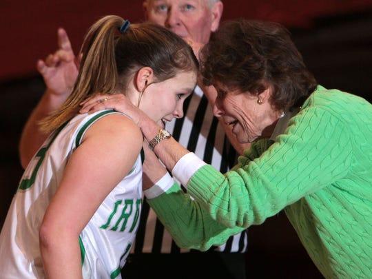 Irvington head coach Gina Maher celebrates with Riley