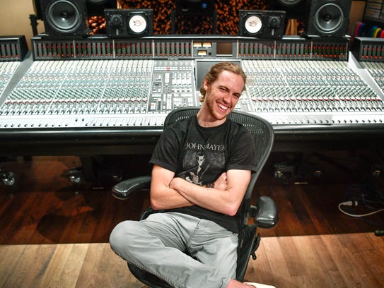 David Francisco sits in front of a soundboard at Blackbird