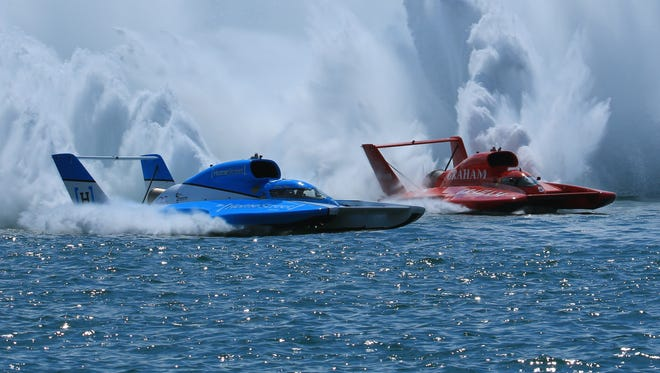 Jimmy Shane (blue boat) and J. Michael Kelly (road boat) duel in the first Unlimited heat Saturday.