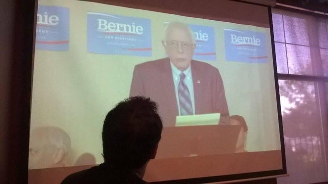 Supporters watch the live stream of Bernie Sanders' speech at the Bar of Wausau in Rothschild on Wednesday night.