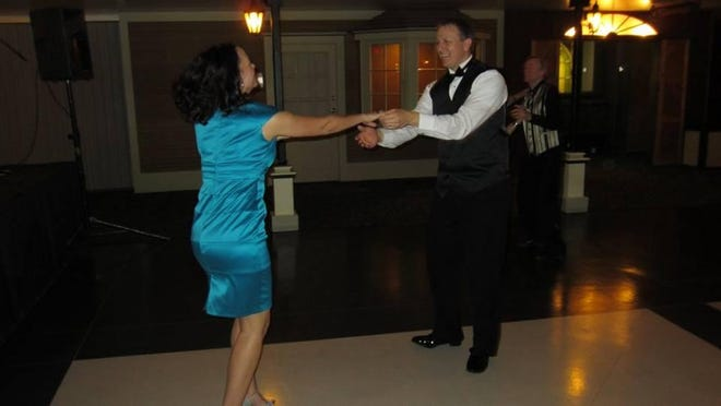 Fortnightly president Dave Grubich and his wife, Valerie, take a spin around the dance floor. The Fortnightly club holds events four times a year.