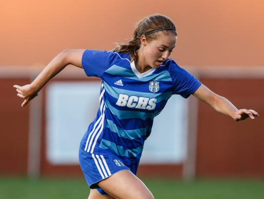 Brookfield Central senior Sarah Knopp  brings the ball downfield at Arrowhead during a match in May.