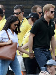Prince Harry and girlfriend Meghan Markle hold hands