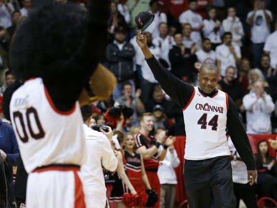 Former Cincinnati Bearcats player Corie Blount raises