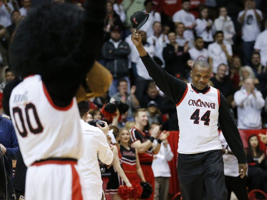 Former Cincinnati Bearcats player Corie Blount raises