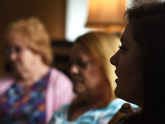 Alicia Casto talks about her and her mother's heroin addictions. Casto's mother Angie died from an overdose in February. Listening are Alicia's grandmother, Tammy Compton, and her great-grandmother Betty Compton, left.