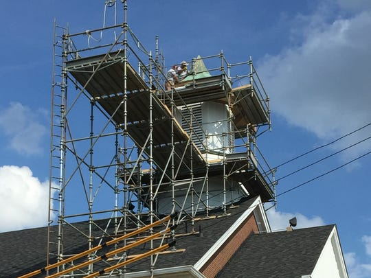 Mr. Roof workers make headway on steeple repair at