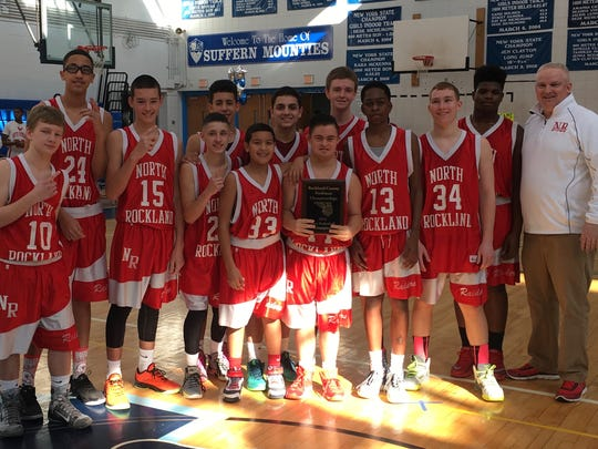 Robbie Alonso holds the plaque from North Rockland's freshman team county championship.