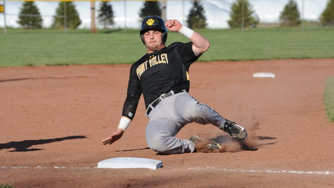 Paint Valley's Teagan McFadden slides into third base April 14 at Unioto High School. McFadden was named first-team all-district Wednesday.