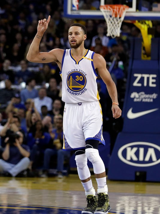 Golden State Warriors guard Stephen Curry (30) celebrates after scoring against the Utah Jazz during the first half of an NBA basketball game, Monday, April 10, 2017, in Oakland, Calif. (AP Photo/Marcio Jose Sanchez)