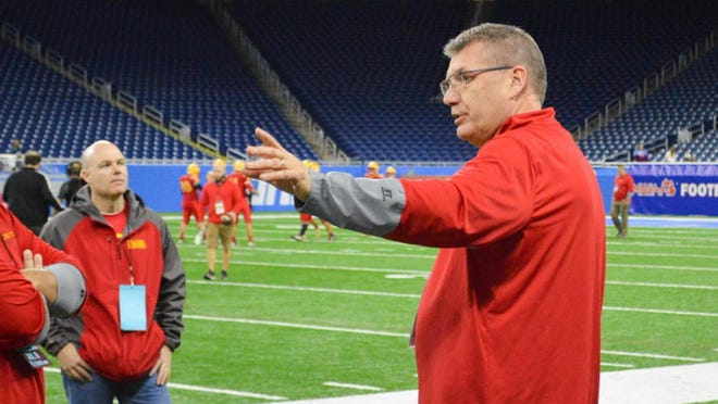 Reading assistant football coach and AD Mitch Hubbard talks with Ranger personnel at Ford Field in this Hillsdale Daily News file photo.