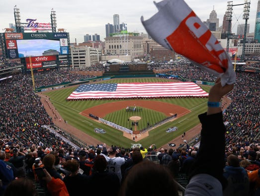 The American flag is draped across the outfield during