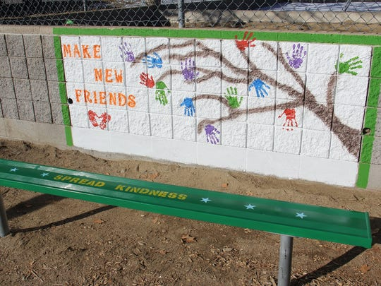 The Buddy Bench, created by Baylee Mee and Marlo Towle, is at Huffaker Elementary School.