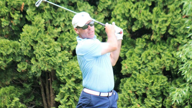Brett Wilson watches his tee shot during the second round of the Seacoast Am golf tournament Saturday at Pease Golf Course.