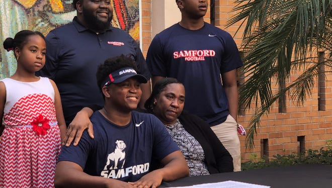 Bishop Verot football player Joe Mera signed with Samford during a ceremony at Bishop Verot on Wednesday.