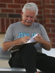 Steve Caswell, the statistician for the John Jay High School boys soccer team, keeping stats in the stands at Carmel High School during game against Carmel Sept. 27,  2017.