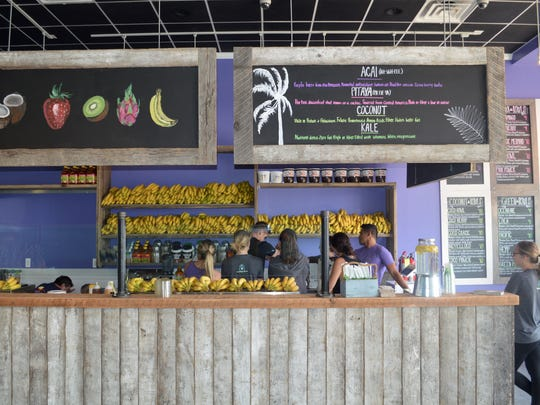 Warm up inside Playa Bowls for a tropical experience.