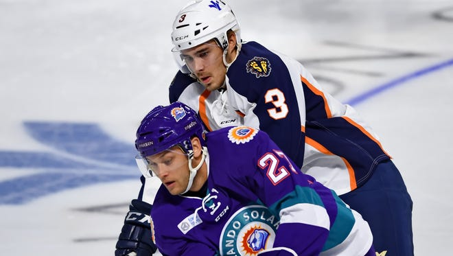 Greenville's Ahti Oksanen battles with Orlando's Eric Faille. The Greenville Swamp Rabbits hosted the Orlando Solar Bears in an ECHL hockey game Friday, Nov. 4, 2016 at BSWA.