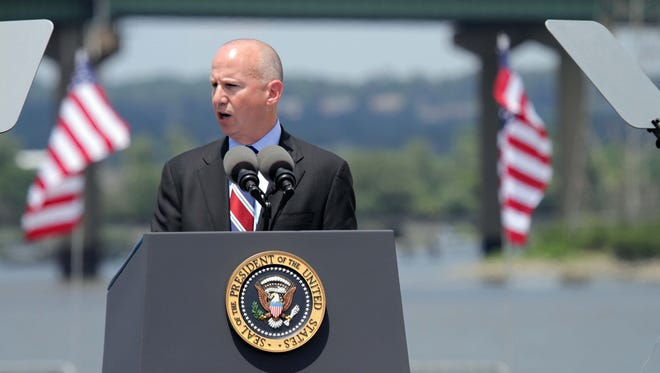 Gov. Jack Markell addresses a audience gathered at the Port of Wilmington, Thursday afternoon, July 17, 2014 before President Obama arrived to give remarks about a new plan to improve the nation's highway infrastructure with damaged I-495 bridge behind the stage.
