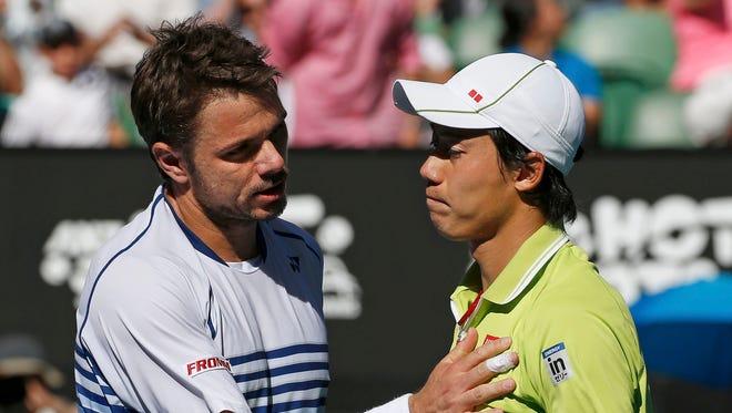 Stan Wawrinka (L) of Switzerland shakes hands with Kei Nishikori of Japan after winning their men's singles quarterfinal match at the Australian Open.