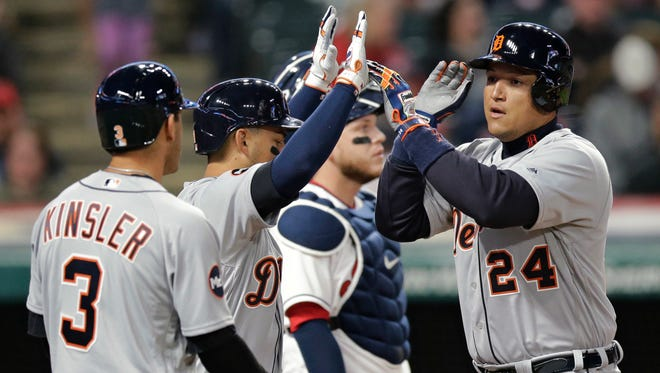 Tigers first baseman Miguel Cabrera, right, is congratulated by Jose Iglesias, center, and Ian Kinsler after Cabrera hit a three-run home run off Indians starting pitcher Trevor Bauer during the fifth inning Friday in Cleveland.