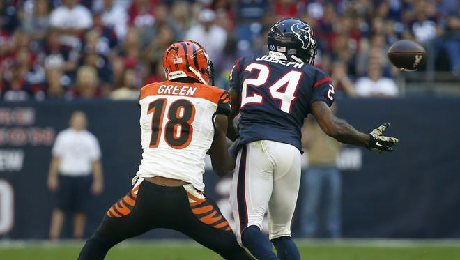 Texans cornerback Johnathan Joseph steps in front of Bengals wide receiver A.J. Green for an interception that he returned for a touchdown during last season's game in Houston.