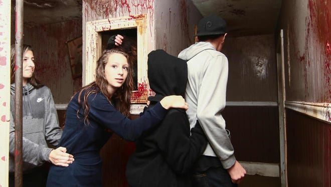 Guests turn a corner while preparing themselves for a scare at Frighland last weekend.