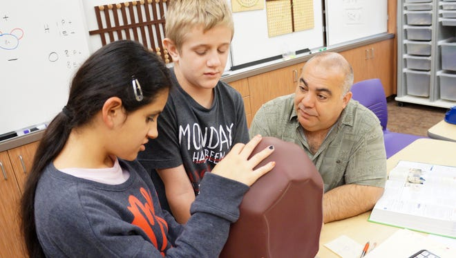 Jeff Killebrew, far right, is an NMSU graduate and a science teacher at the New Mexico School for the Blind and Visually Impaired. He has attracted national attention for two devices he invented to help blind students learn math and science concepts, and for recently training with NASA scientists aboard an airborne observatory.