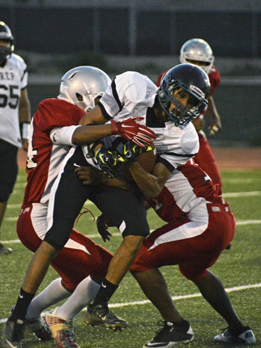 Navajo Prep's Dante Alonzo gets taken down by the Shiprock defense during a Sept. 26, 2014, game at Chieftain Stadium in Shiprock.
