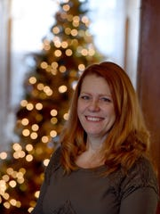 Cheryl Tomjack opened her home to neighbors for a party at the conclusion of a caroling session.