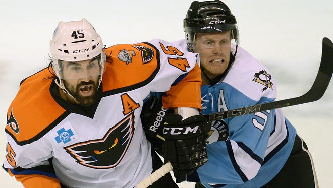 Lehigh Valley Phantoms' Zack Stortini, left, and Wilkes-Barre/Scranton Penguins' Philip Samuelsson battle for position Saturday, Oct. 11, 2014, during an AHL hockey game in Wilkes-Barre, Pa. (AP Photo/Citizens' Voice/Andrew Krech)
