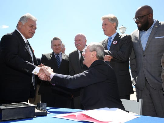 Ocean County Freeholder Joseph Vicari (left) shakes hands with Gov. Phil Murphy at a bill signing ceremony in Point Pleasant Beach in this Asbury Park Press file photo from 2018.