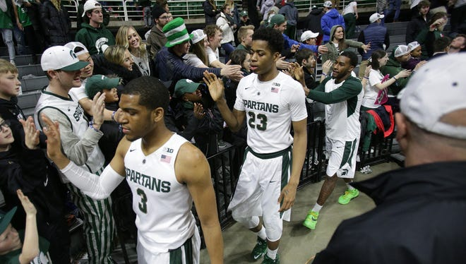 Michigan State's Alvin Ellis III, Deyonta Davis, and Javon Bess greet the Izzone after defeating Indiana, 88-69, at the Breslin Center on Feb. 14.