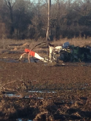 Fuselage of crashed helicopter rests in the marshy