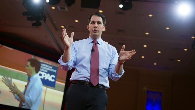 Wisconsin Gov. Scott Walker gestures while speaking during the Conservative Political Action Conference (CPAC) in National Harbor, Md., Thursday, Feb. 26, 2015. (AP Photo/Cliff Owen) ORG XMIT: MDCO124