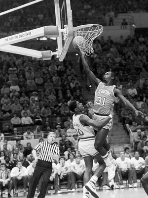 Dwayne Washington of Syracuse University makes a breakaway layup as Earl Kelley of the University of Connecticut tries to stop him during a game Jan. 19, 1984. Syracuse won easily, 95-68.