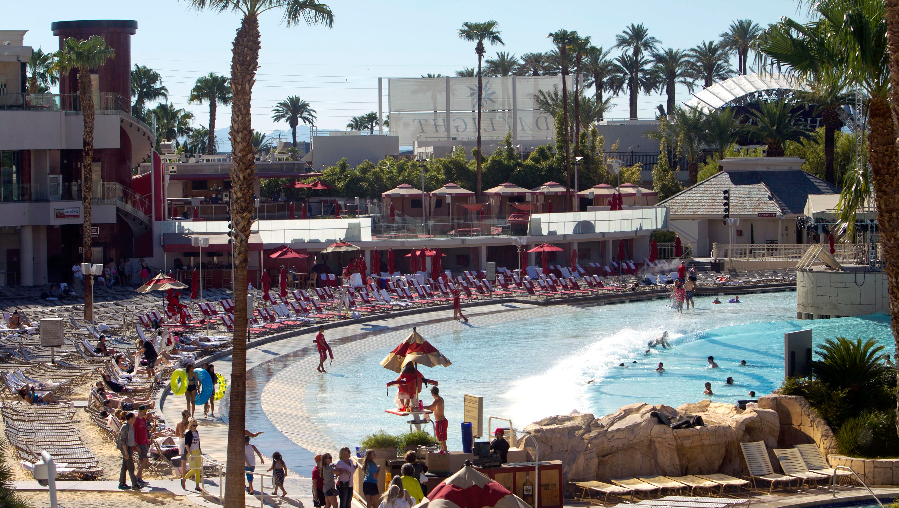 The Mandalay Bay pool area is set on 11 acres, with unique features such as: real sand, a wave pool, a comfortable beach side casino, and beach side concerts during the summer. Adding to the beach-like pool area at the Mandalay Bay are luxurious amenities like cabanas, bungalows, day beds, and villas to rent for that all-exclusive experience.